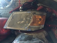 2009 Dodge Grand Caravan headlight driver side front  Calgary, T1Y