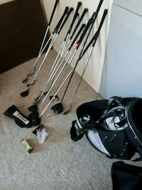 black and gray golf bag with golf clubs Calgary