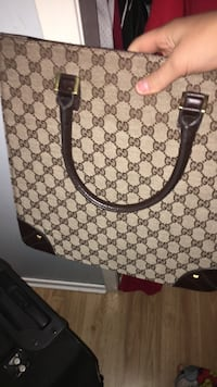 Brown and black monogram gucci leather tote bag Kamloops, V2B 4S3