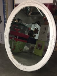 oval white wooden framed mirror
