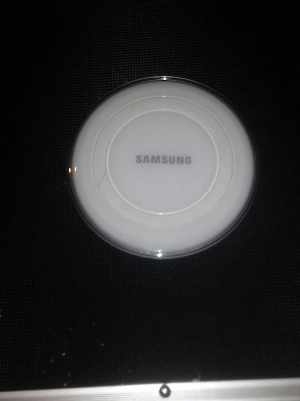 white Samsung wireless charging pad
