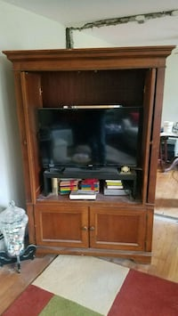 brown wooden TV hutch with flat screen television 369 mi