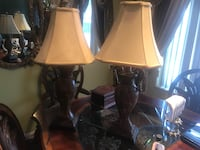 two brown wooden base with white lampshade table lamps