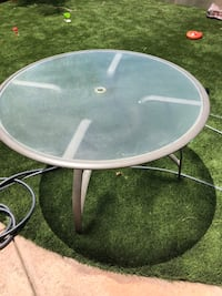 Patio table set. Metal table with glass top. 5 matching chairs  Temecula, 92592
