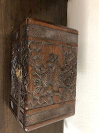Old carved wood jewelry chest