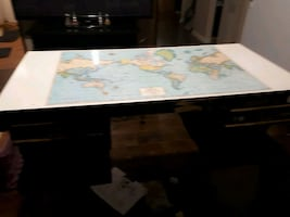 desk with map on it