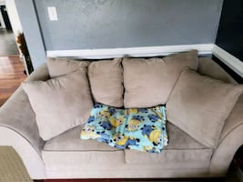 gray fabric sectional sofa with throw pillows