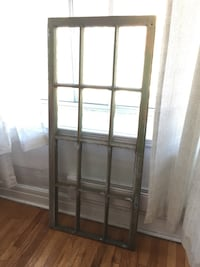 Giant rustic antique window frame with glass panes
