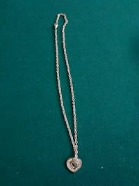 silver-colored diamond encrusted heart pendant with chain necklace