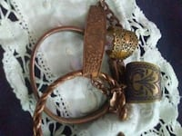 two copper-colored engraved rings Kingston