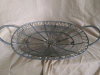 round gray metal wall decor