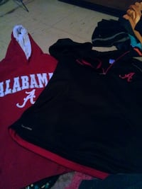 two red and black Alabama Crimson Tide shirts