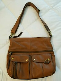 brown leather crossbody bag with tassel