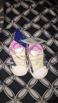 Pair of baby's pink-and-black adidas superstar shoes