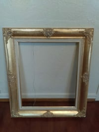 brown wooden framed wall mirror Oklahoma City, 73109