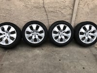 four gray 5-spoke vehicle wheels and tires 2268 mi