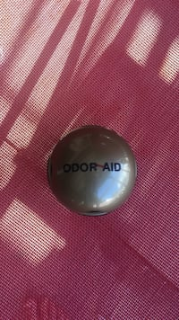 round brown Odor Aid device