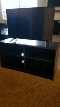 black wooden TV stand with flat screen 32 in Salt Lake City, 84109