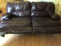 Leather reclining couch and loveseat