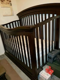 Baby bed/ Crib with matching changing table and mattress.