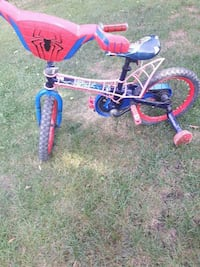 toddler's blue and white bicycle with training wheels 521 km