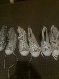three pairs of white low-top sneakers Toronto, M3L 1L7