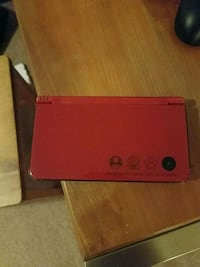 red and black Nintendo DSI XL 26 mi