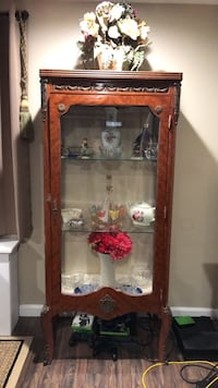 Ornate and decorative glass curio antique replica 2 Glass shelves. Uses a skeleton key that is broken in the door so it needs to be opened up and repaired with a new skeleton key. Easy fix. Very cute piece for any living room or dining room.. Glen Cove, 11542