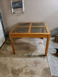 Table with removable glass