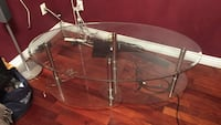Stainless steel base oval glass center table Vancouver, V5V 4P2