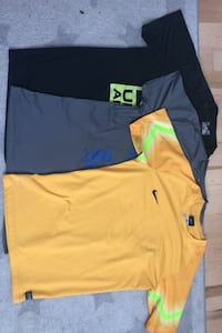 3 active wear shirts under armour and nike Edmonton