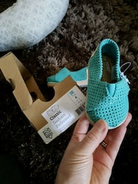 pair of baby's teal crib shoes with brown box Winnipeg, R2N 2J9