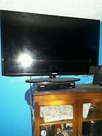 black flat screen TV with remote The Bronx, 10466