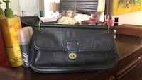 Authentic Coach Clutch in great condition. All it needs is a cleaning with leather cleaner and it would be good as new! Originally bought for 110 willing to let it go for 40 dollars ! Glen Burnie, 21061