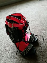red and black backpack and black leather bag 941 mi