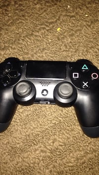 black Sony PS4 wireless controller Ajax, L1T