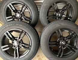 MINT CONDITION 4 x 225/65/17 TIRES AND BMW RIMS  $$800