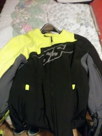 black and green riding jacket and helmet  Cleveland, 37311