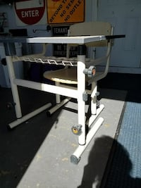 white metal-based chair and table