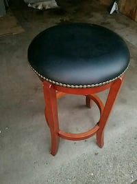 round brown wooden framed black leather padded sea Whiting
