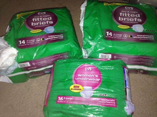 3 opened packaged attends adult diapers CVS fitted briefs and underwear  packs