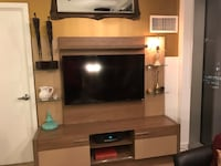 """Light brown entertainment center with 3 cabinets, one always open, and includes 49"""" TV Chicago, 60601"""