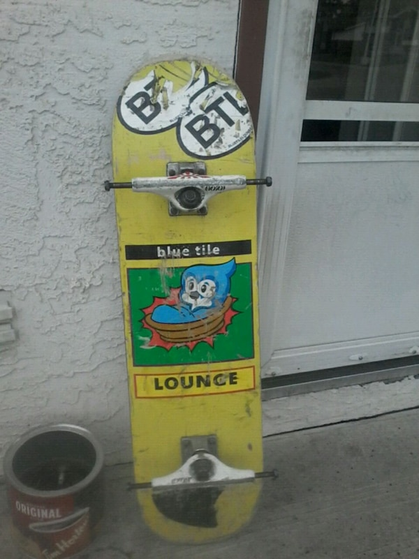 yellow and black snowboard with bindings