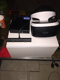 white and black virtual reality headset with Sony PS4 original