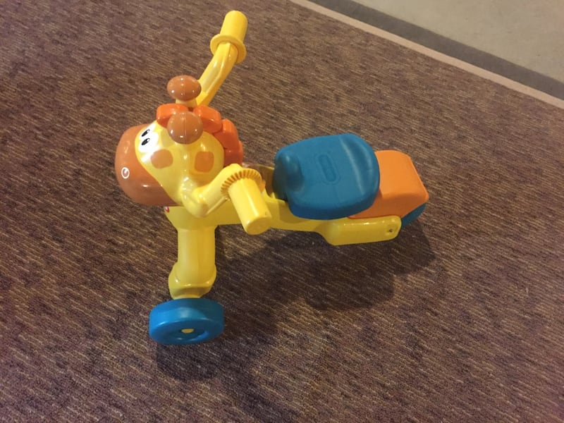 Toddler's yellow and blue trike ad9df8b5-e8f4-4713-bc10-fe265c399434