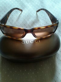 Gucci sunglasses with the case.