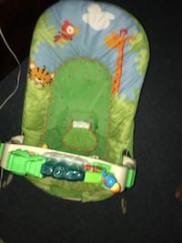 baby's blue and green jungle-themed bouncer
