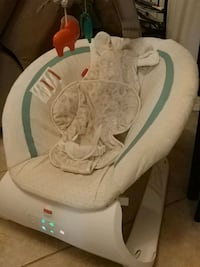 baby's white and green bouncer Ocala, 34475