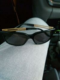 black and brown framed sunglasses Los Angeles, 90028