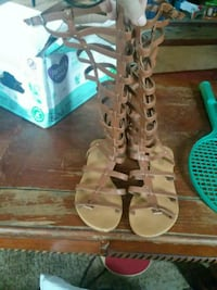 pair of brown leather gladiator sandals Vancleave, 39565
